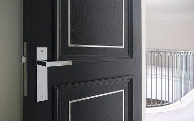 open black internal wooden door leading to the hallway