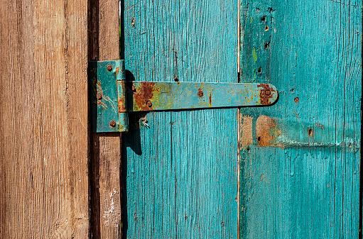 How do you repair a crack in a wooden door?